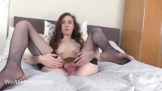 Mercy Quinn poses with reference to black before masturbating